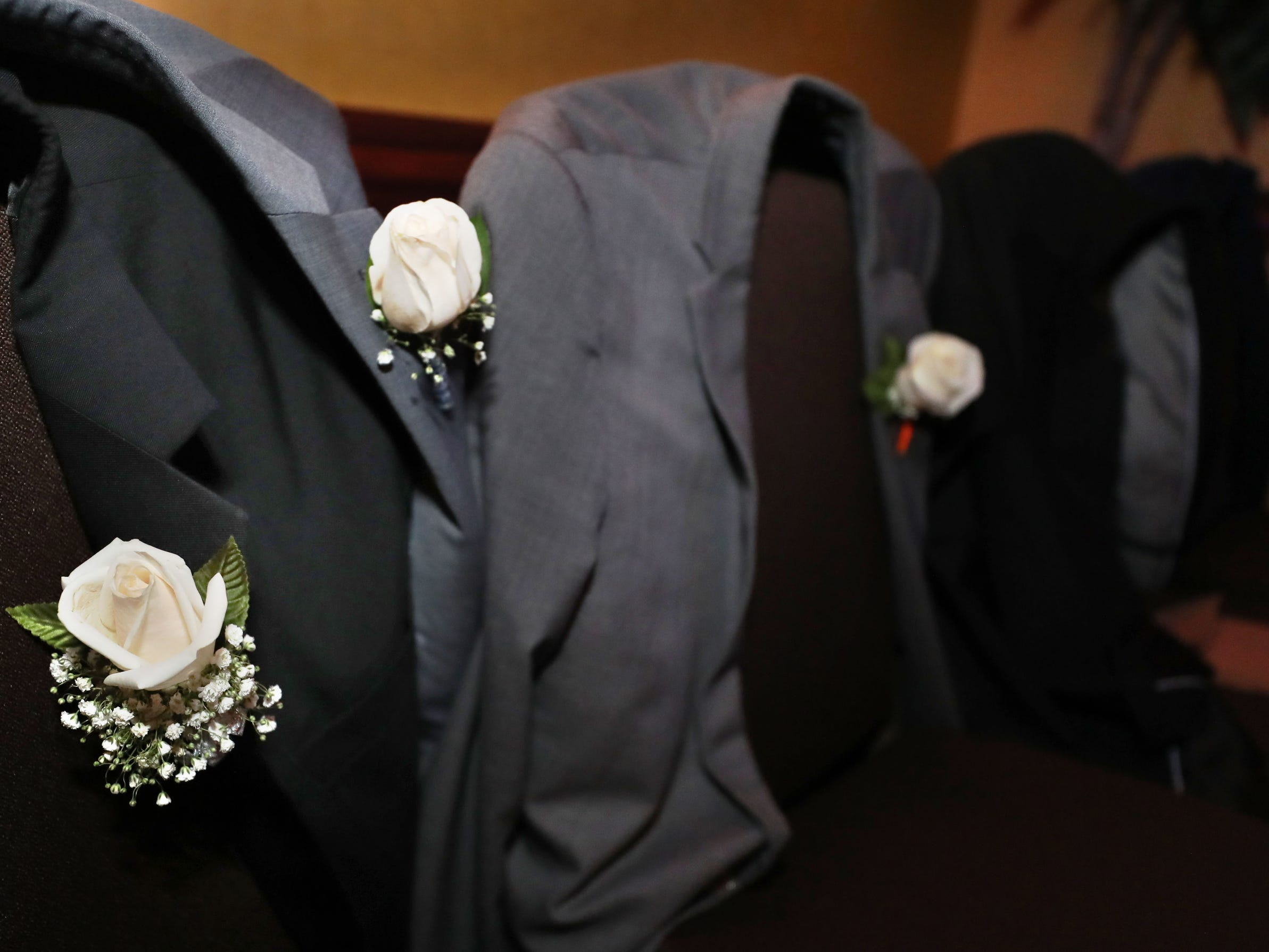 Jackets with corsages are over chairs as student take to the dance floor at Eagleville's Prom held at Embassy Suites, in Murfreesboro on Thursday April 5, 2019.