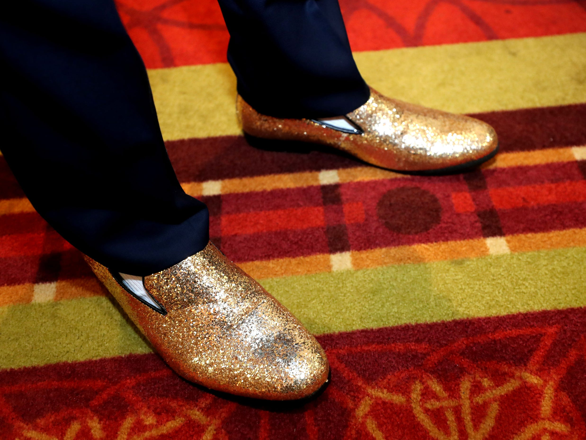 Bryce Lane shows off his sparkly shoes at Eagleville's Prom held at Embassy Suites, in Murfreesboro on Thursday April 5, 2019.