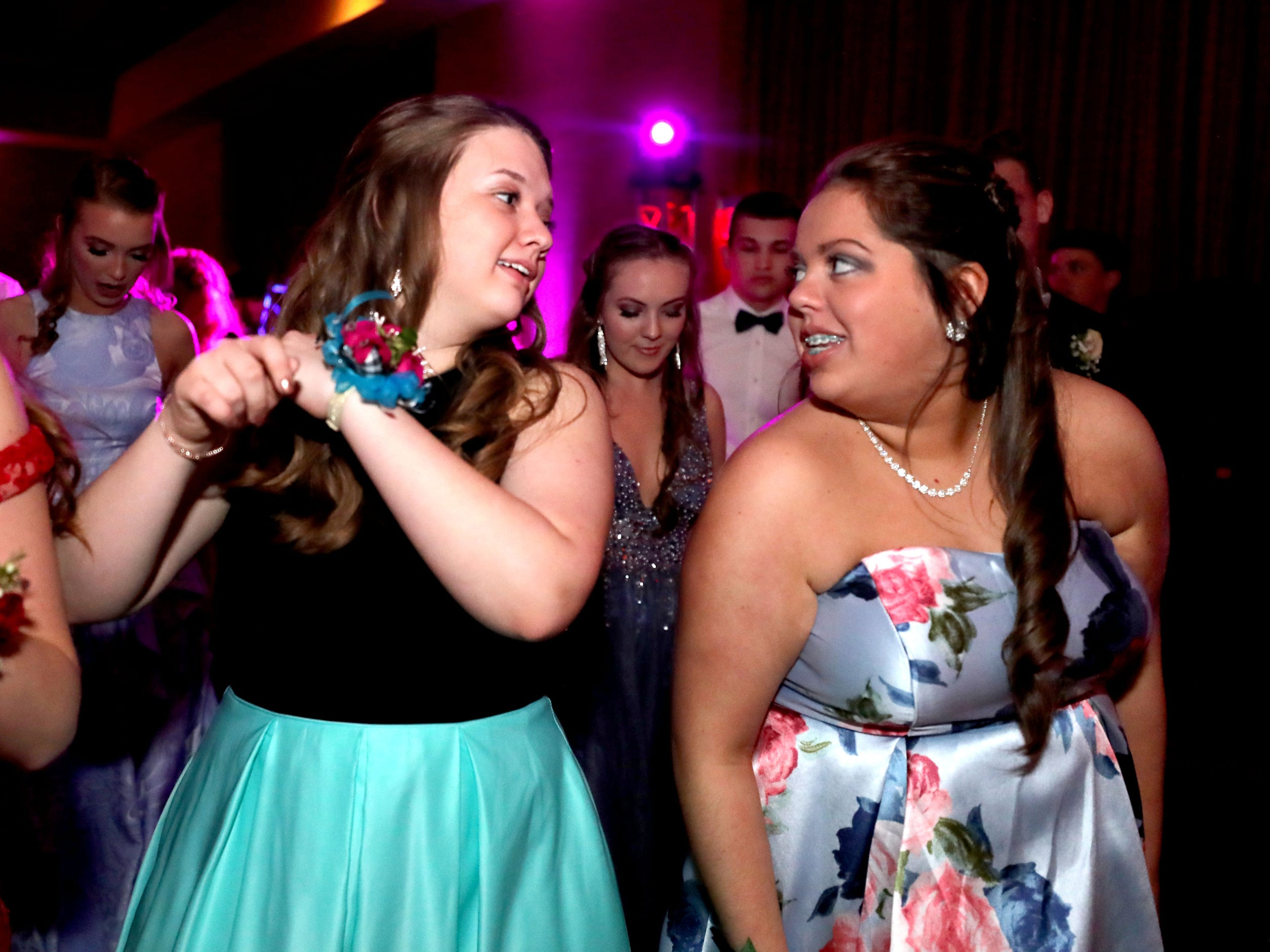 Madalyn Follis, left and Summer Cooper, right dance at Eagleville's Prom held at Embassy Suites, in Murfreesboro on Thursday April 5, 2019.