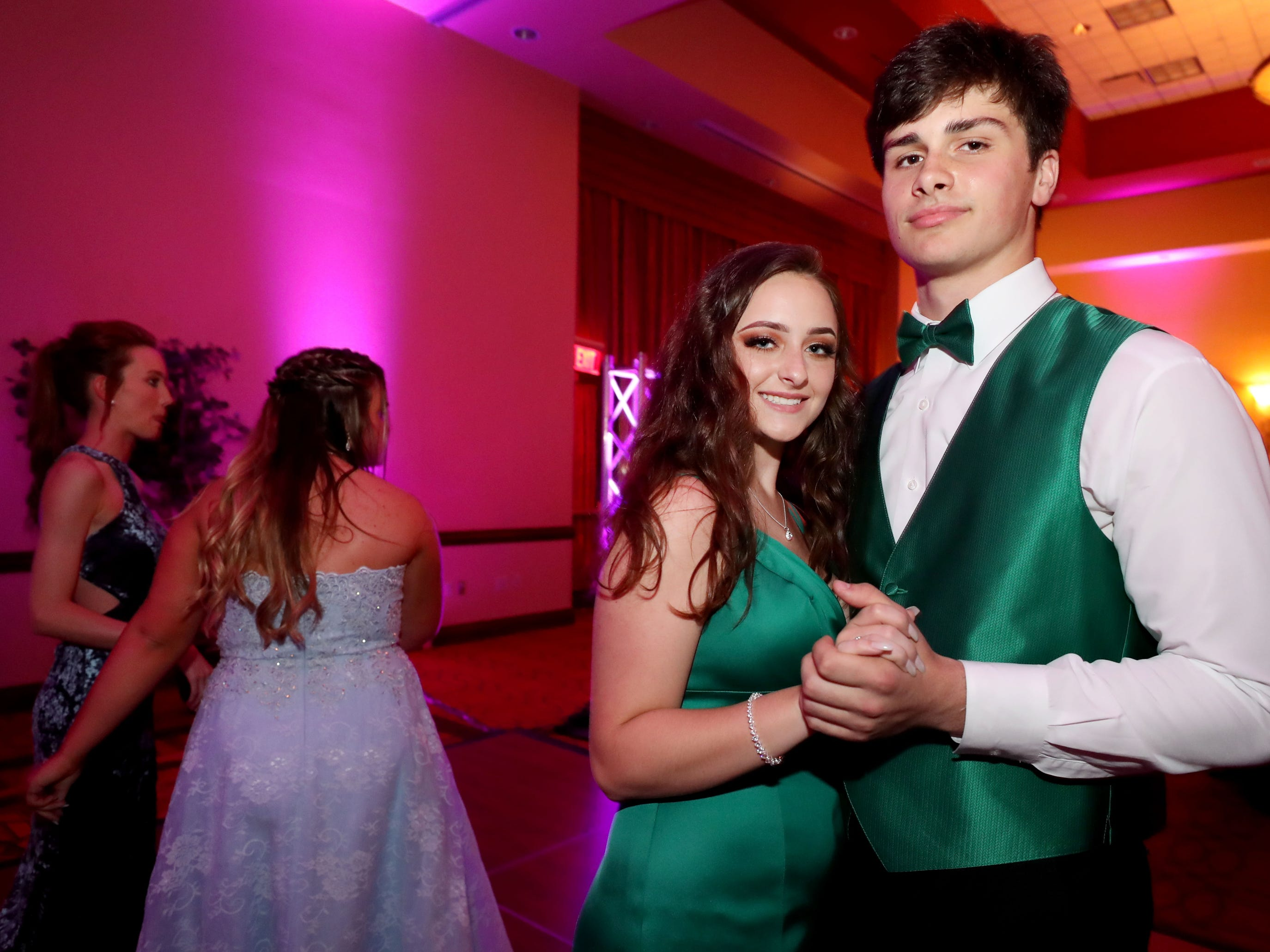 """Haylee Amerman, left and Joey Johnson, right  dance to """"At Last"""" at Eagleville's Prom held at Embassy Suites, in Murfreesboro on Thursday April 5, 2019."""