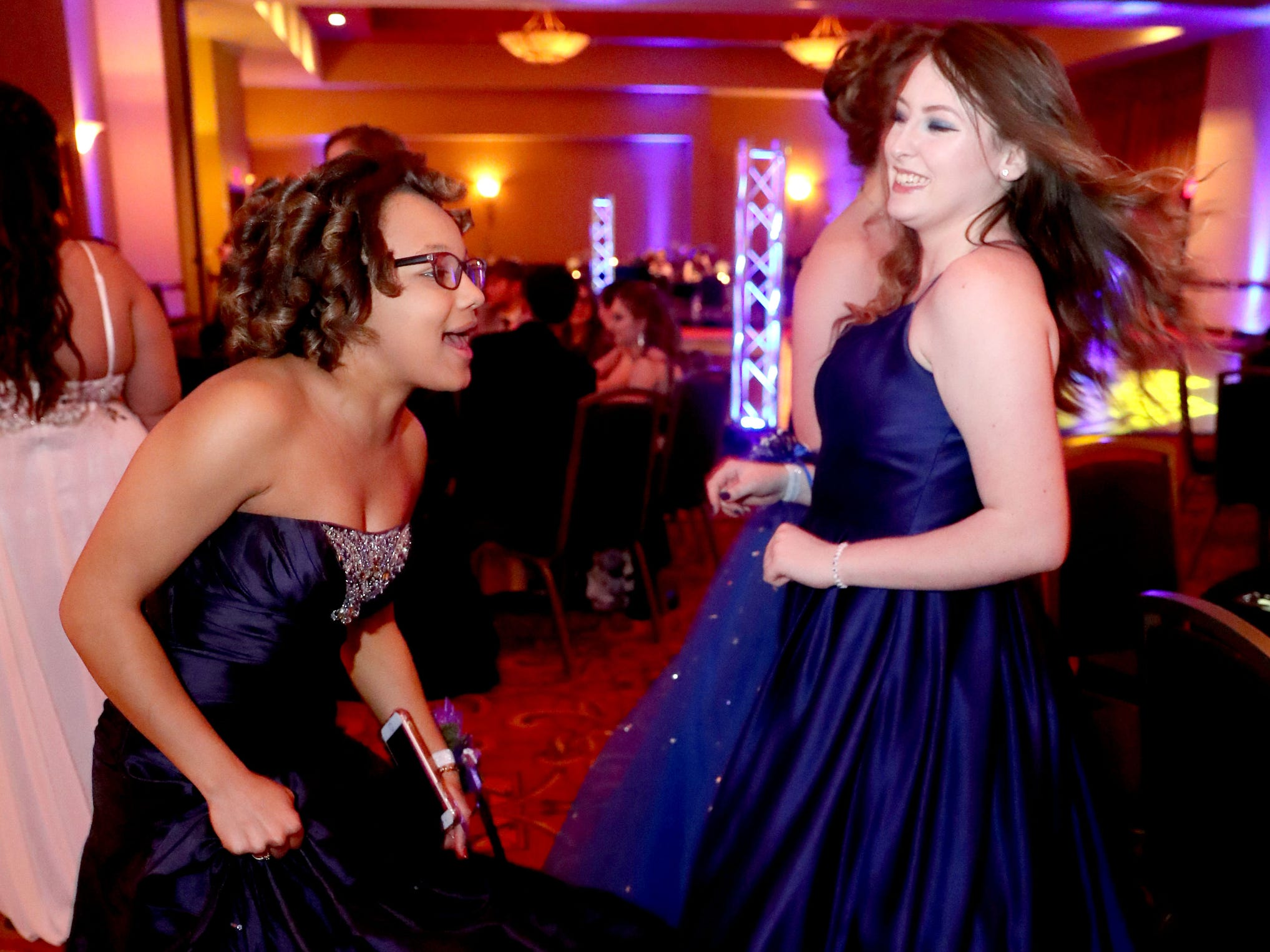 Lexie Miller, left and Aidon Thompson start dancing at Eagleville's Prom held at Embassy Suites, in Murfreesboro on Thursday April 5, 2019.