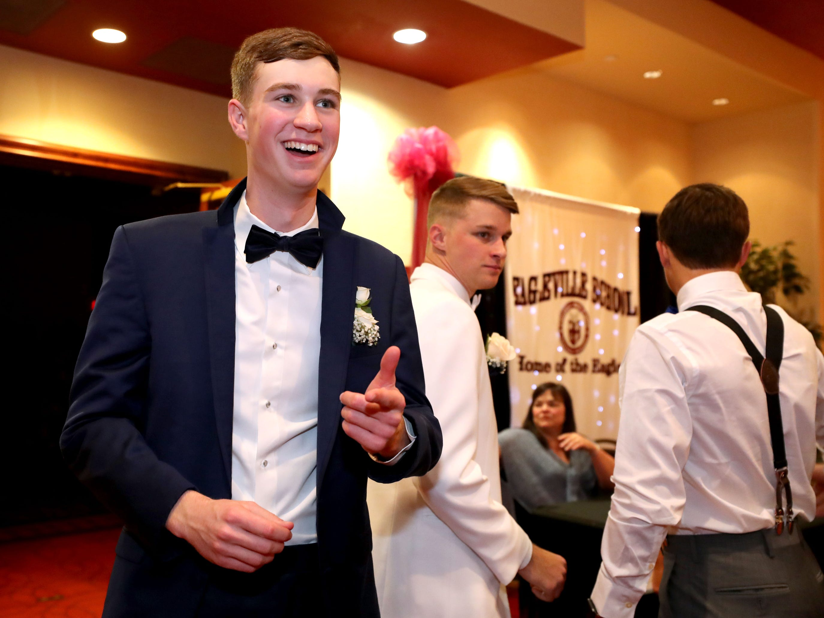 Ivie Burns III greats his friends at Eagleville's Prom held at Embassy Suites, in Murfreesboro on Thursday April 5, 2019.