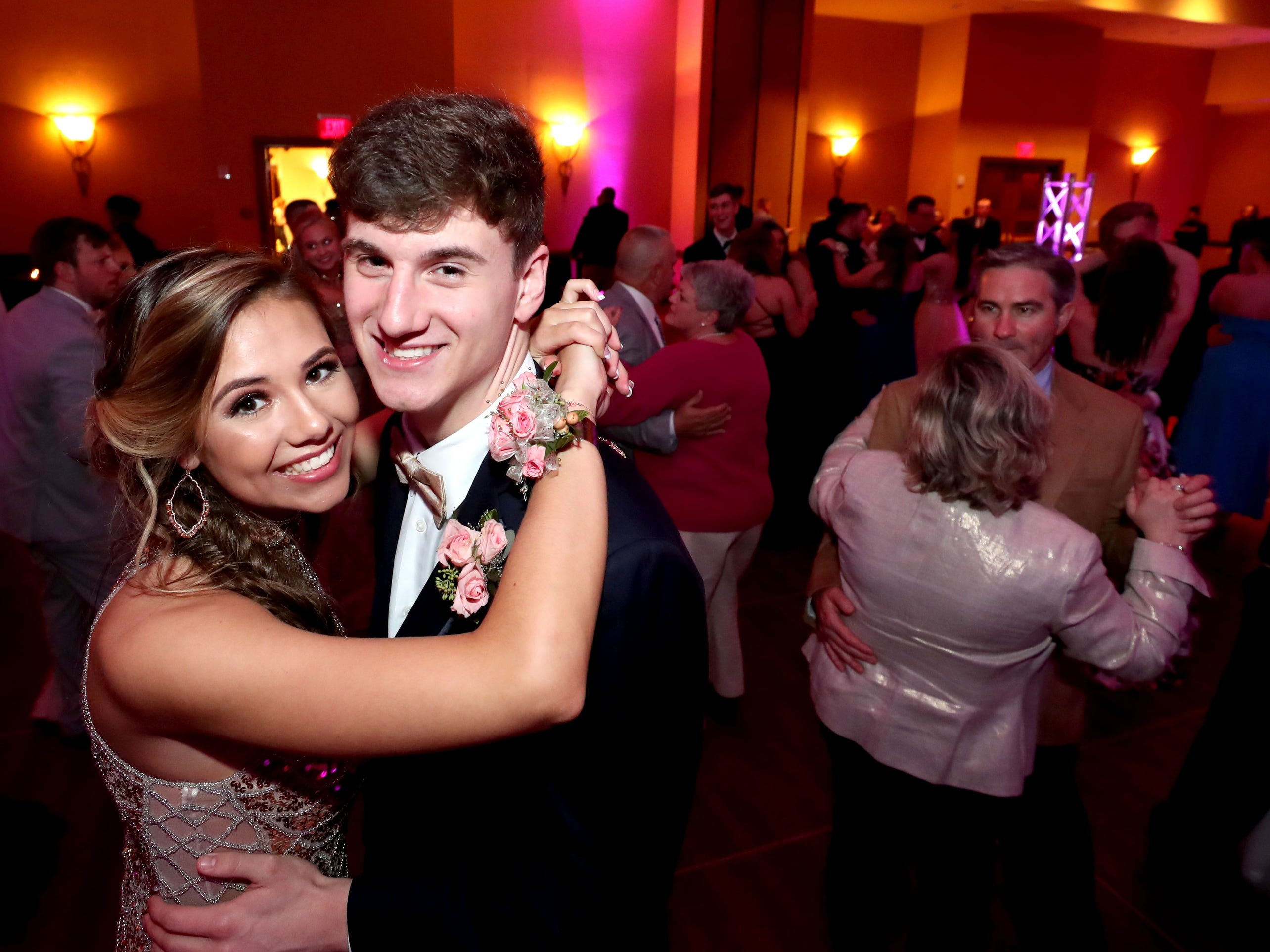 """Lizzy Thompson, left and Lucas Webb, right  dance to """"At Last"""" at Eagleville's Prom held at Embassy Suites, in Murfreesboro on Thursday April 5, 2019."""