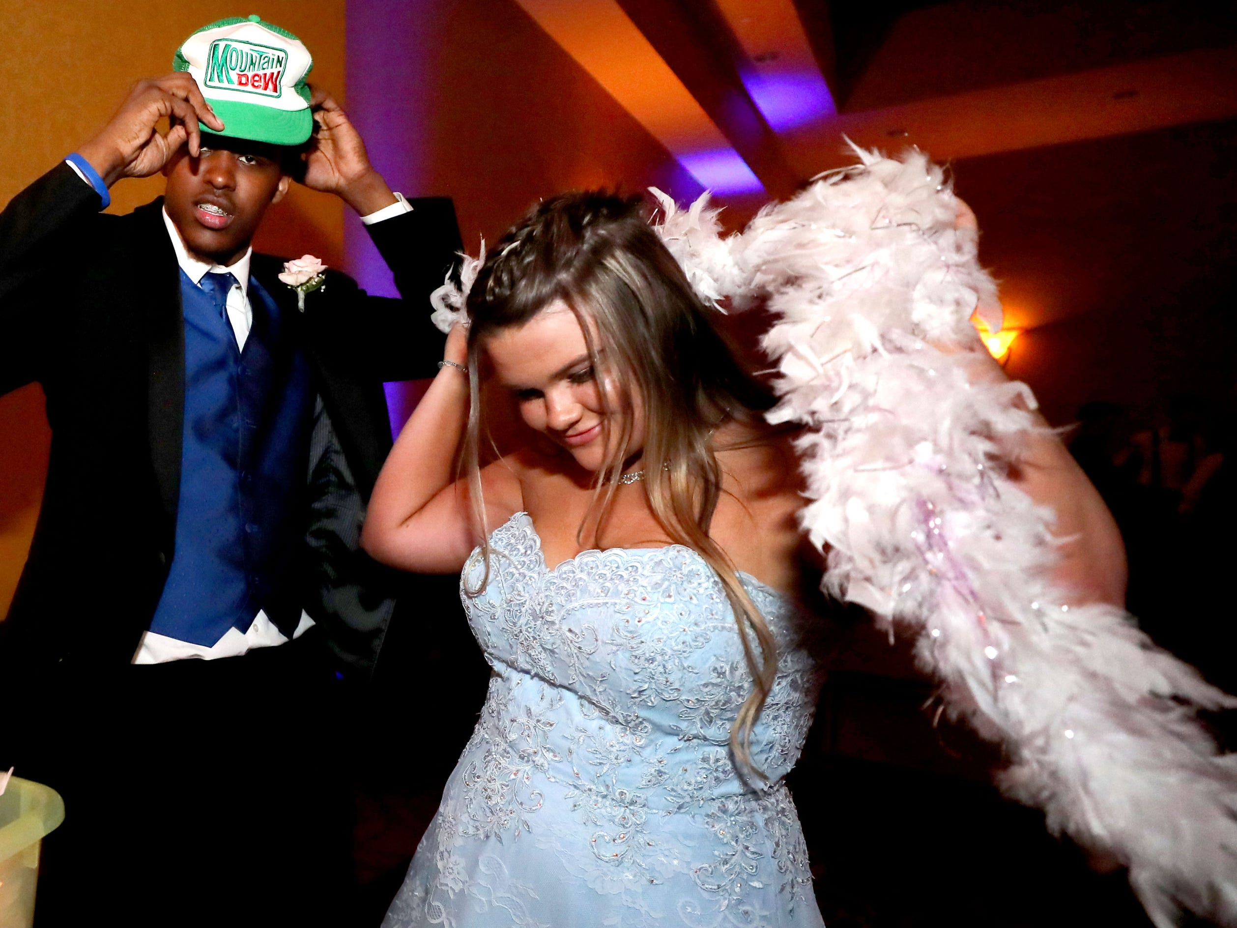 DeMarious Stoudemire, left and Kayleigh Martin, right try on costumes for a picture at Eagleville's Prom held at Embassy Suites, in Murfreesboro on Thursday April 5, 2019.