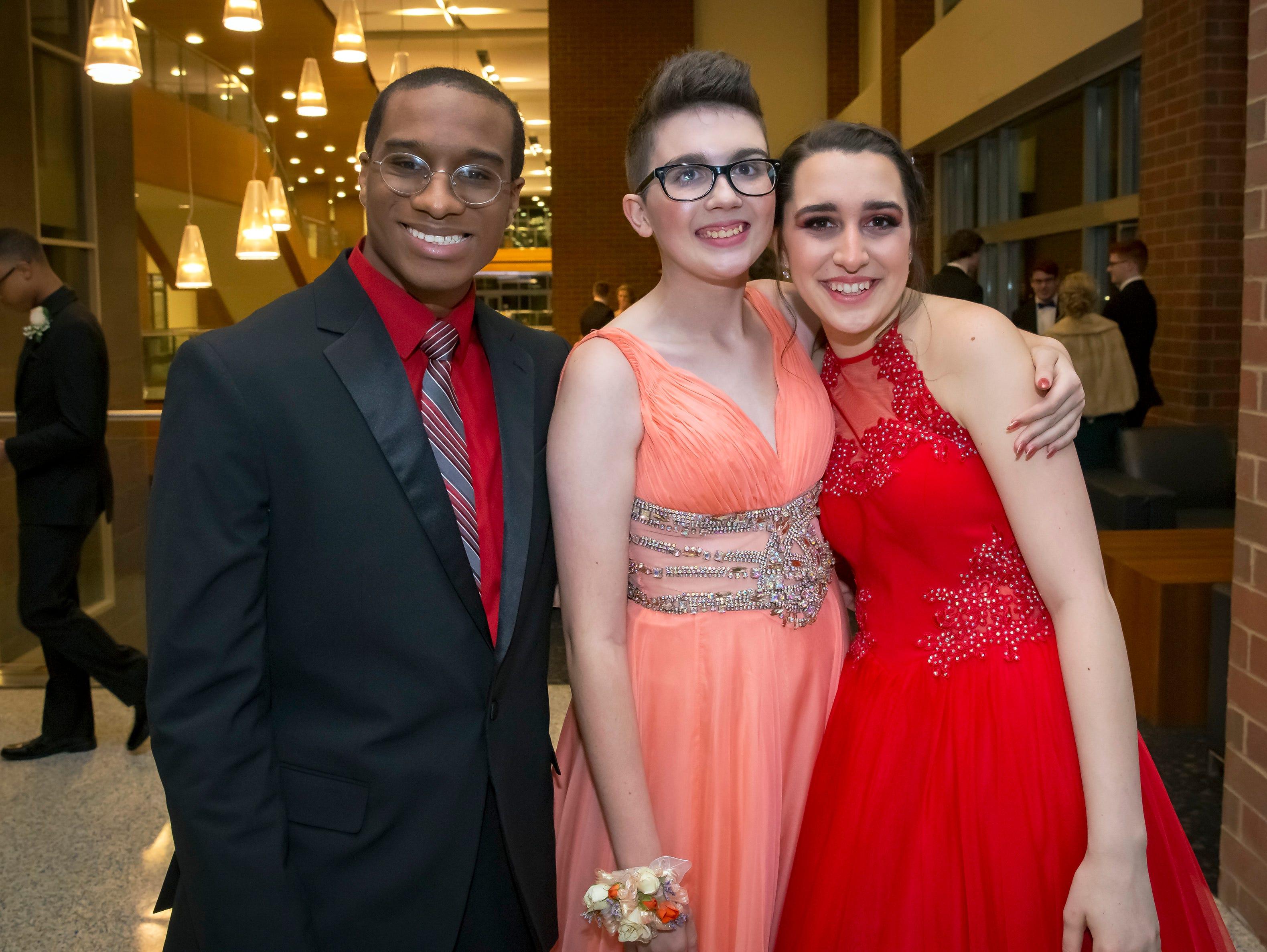 Jaden Banks, Mara Metcalf and Hannah Manning arrive at the Stewarts Creek High School prom held at MTSU, Friday, April 5, 2019.
