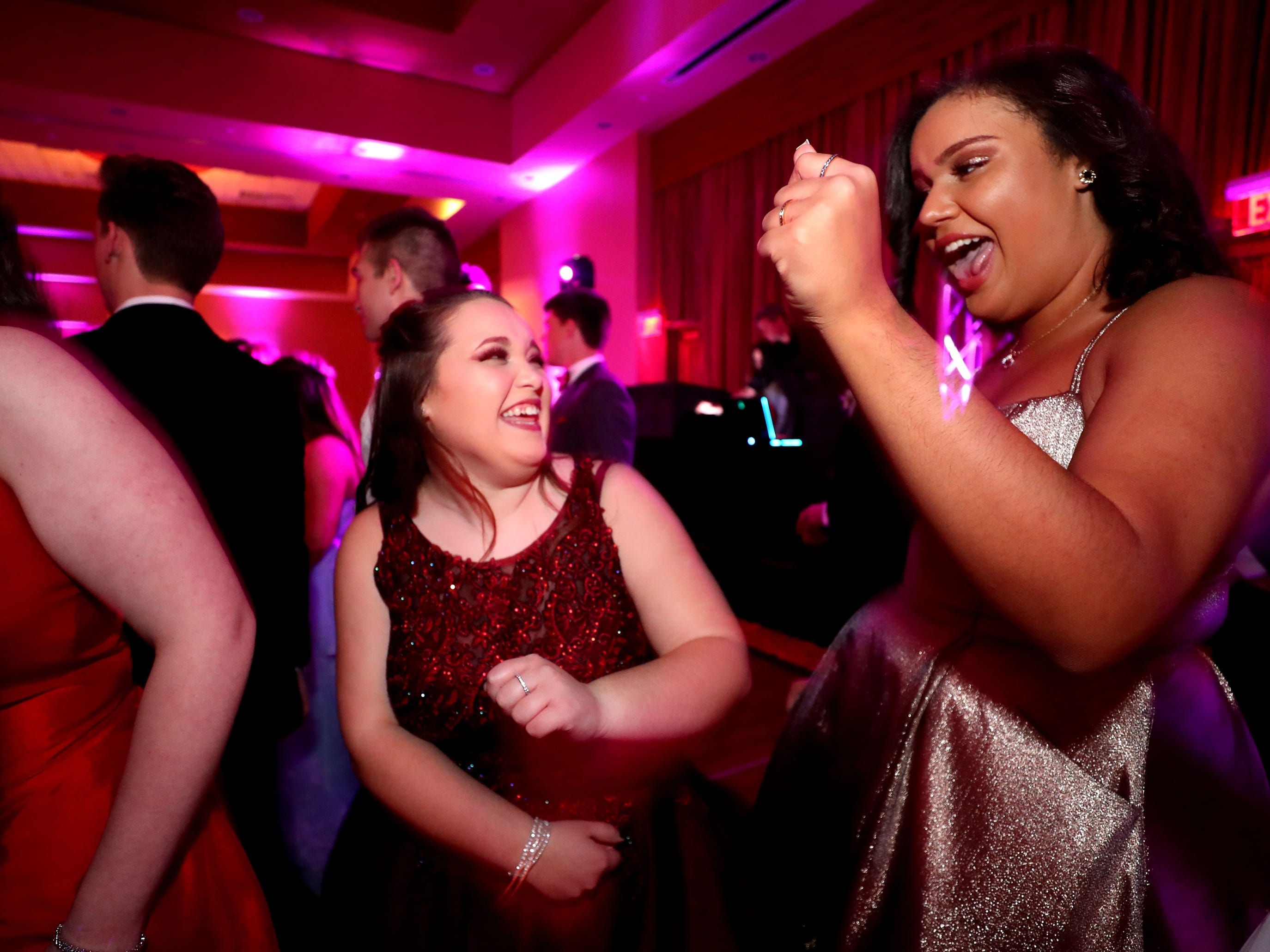 Mikaiah Martin, left and Sierra Givens, right dance at Eagleville's Prom held at Embassy Suites, in Murfreesboro on Thursday April 5, 2019.
