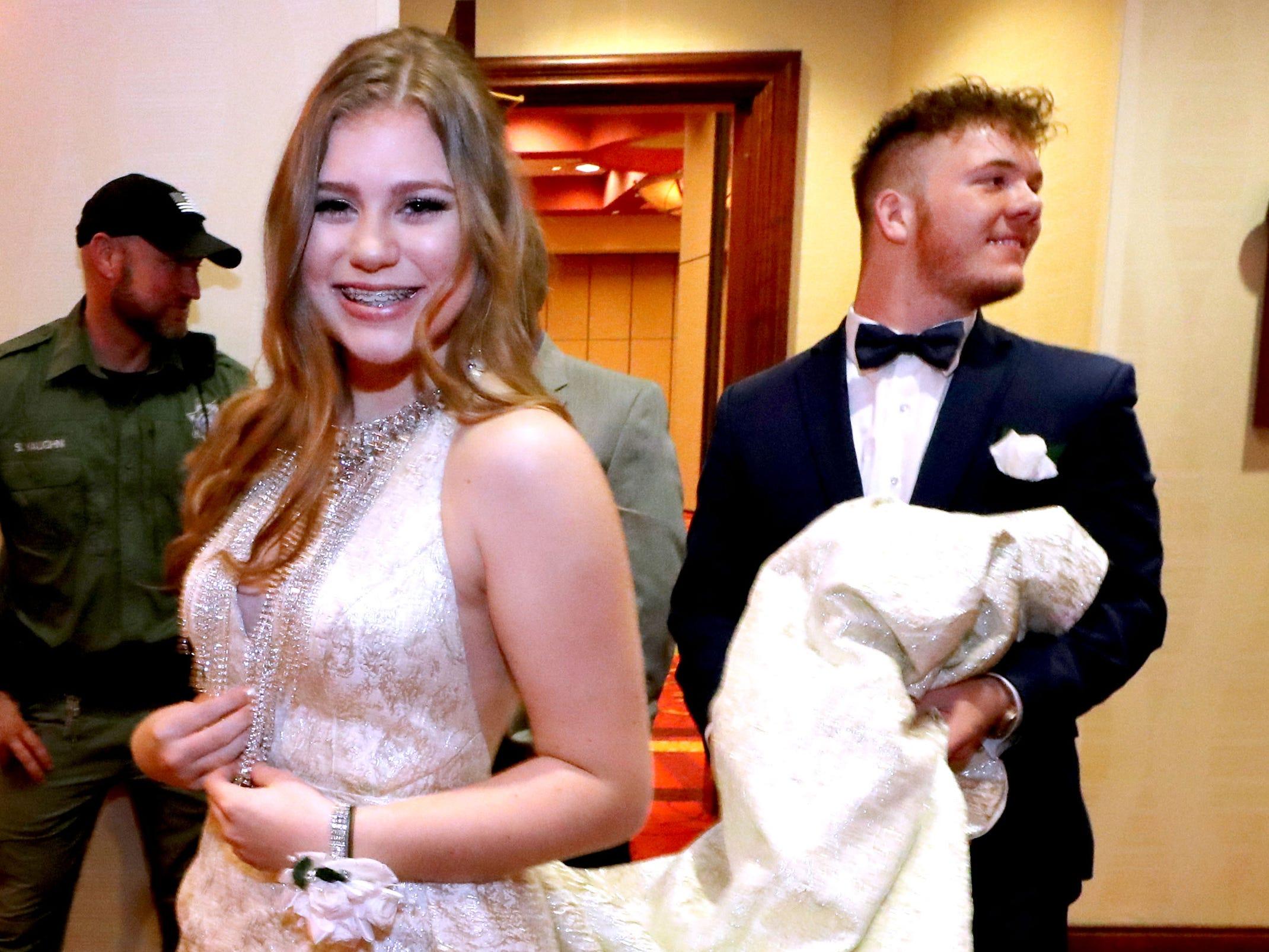 Carl Gudvangen holds Hannah Batt's dress off the ground at  Eagleville's Prom held at Embassy Suites, in Murfreesboro on Thursday April 5, 2019.