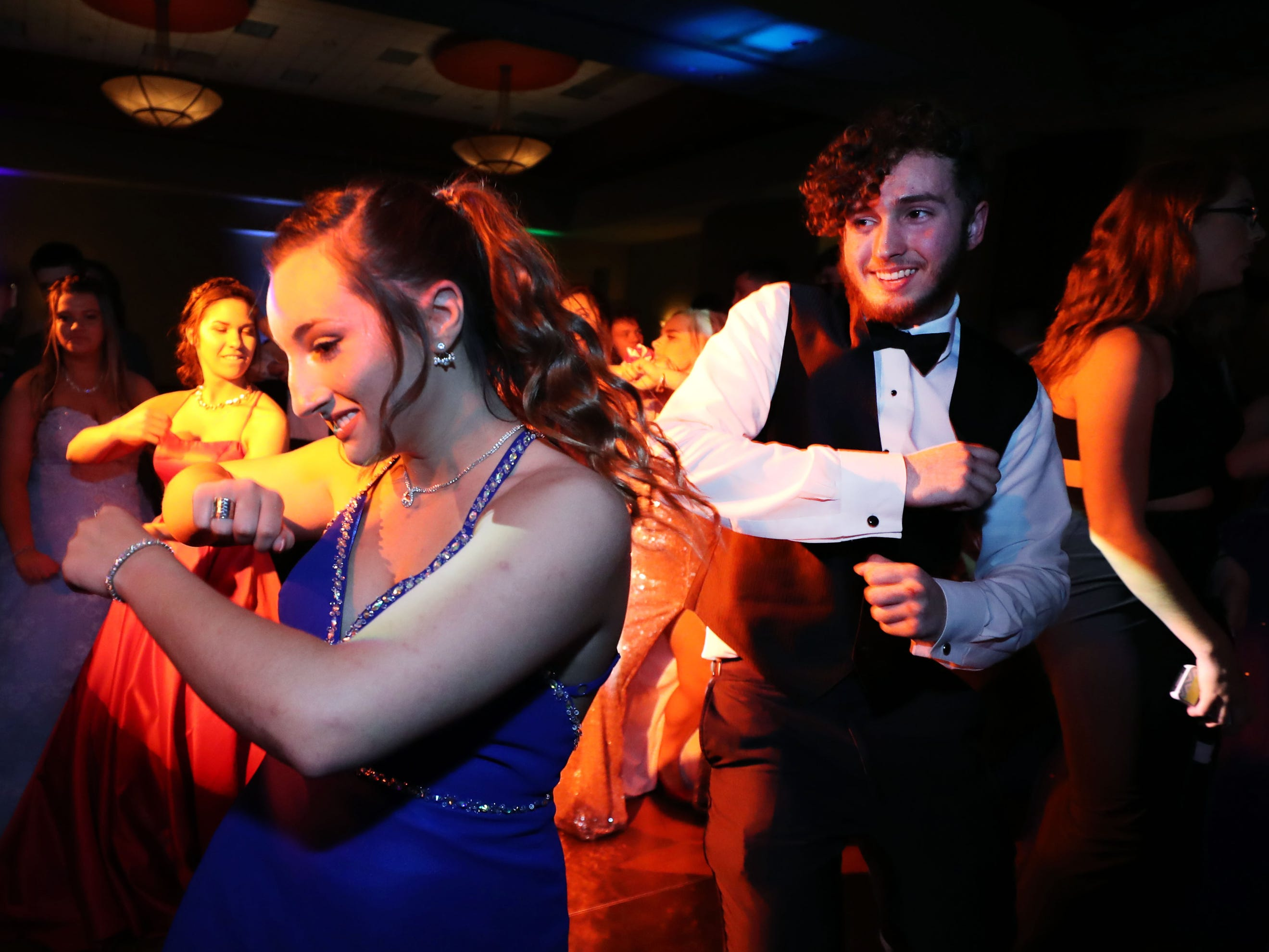 Mackenzie Feasel, left and Sebastin Parrott, right dance at Eagleville's Prom held at Embassy Suites, in Murfreesboro on Thursday April 5, 2019.
