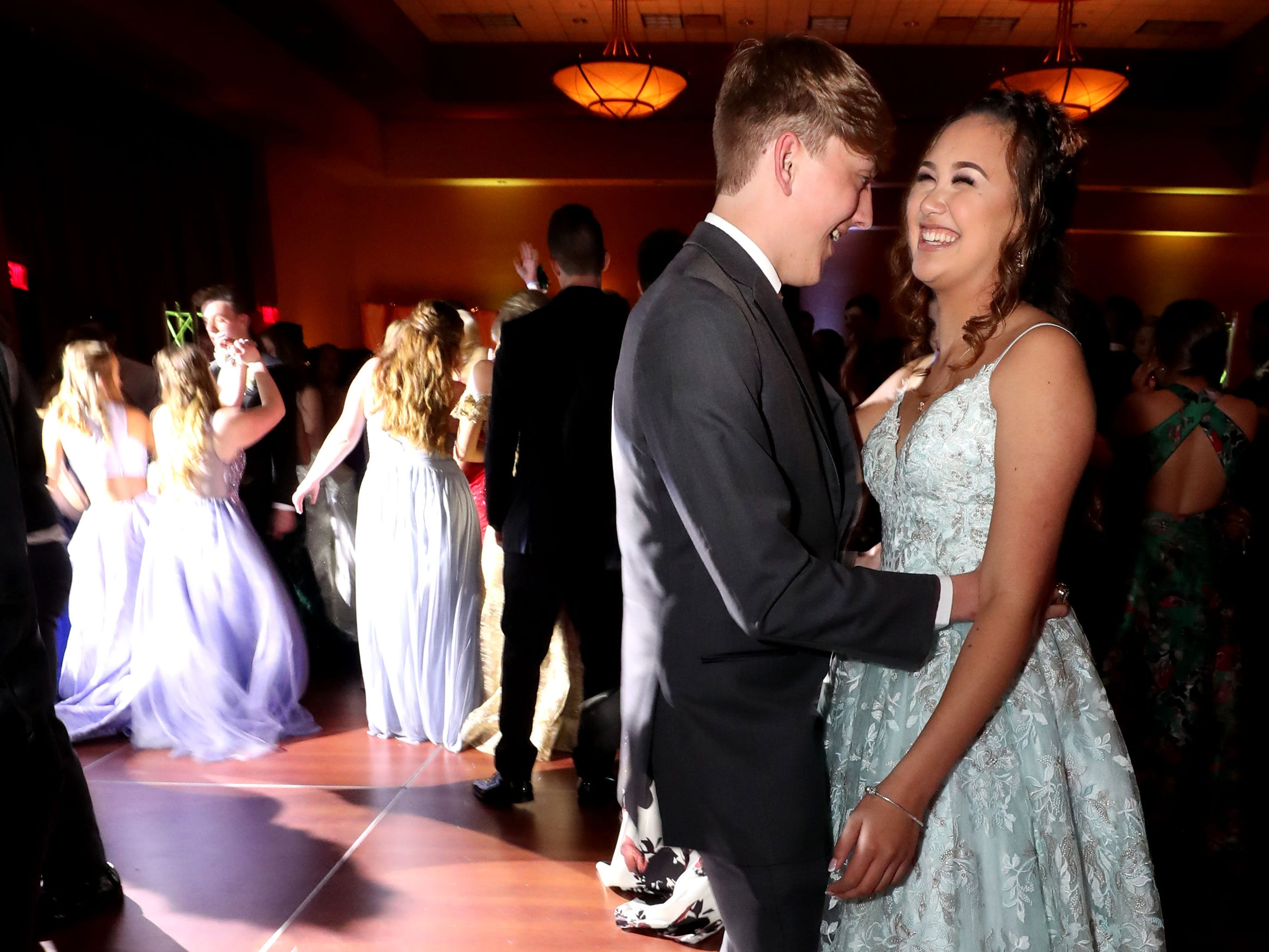 Ethan Hurts, left and Jasmine Huntsman, right dance at Eagleville's Prom held at Embassy Suites, in Murfreesboro on Thursday April 5, 2019.