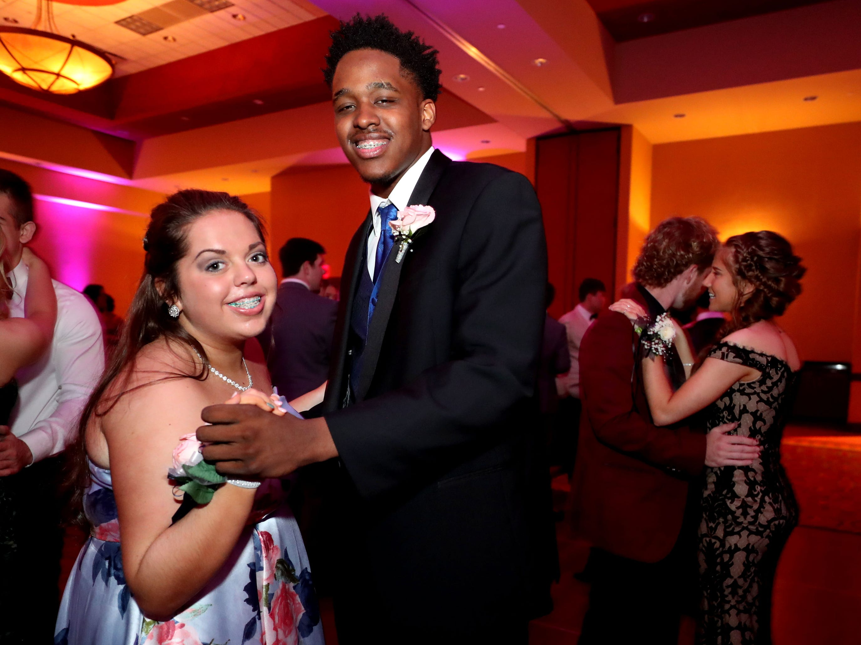 """Summer Cooper, left and DeMarious Stoudemire, right  dance to """"At Last"""" at Eagleville's Prom held at Embassy Suites, in Murfreesboro on Thursday April 5, 2019."""