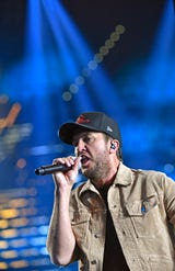 "Luke Bryan rehearsing his new single ""Knockin' Boots"" that he will perform at the ACM's"