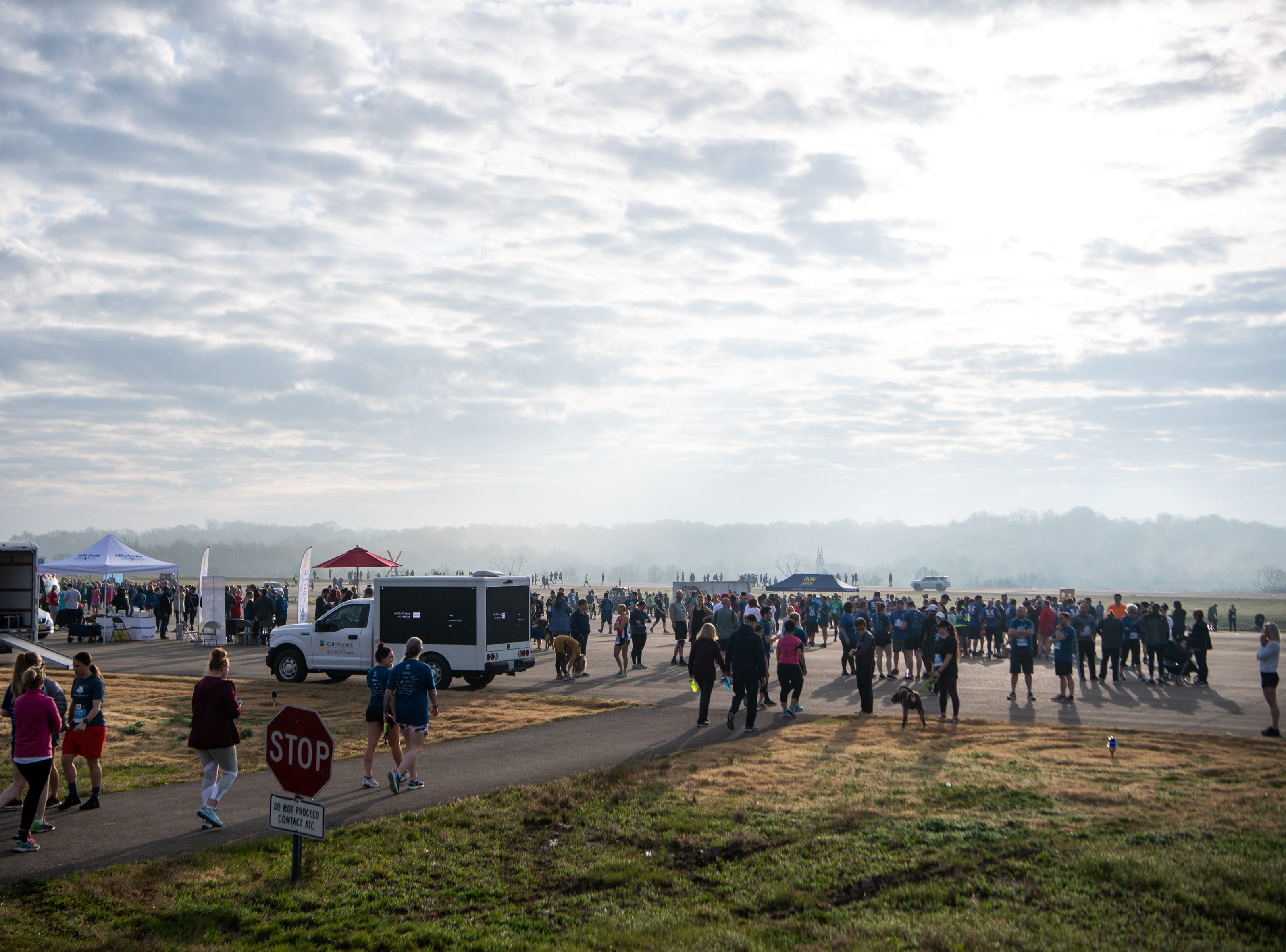 People arrive at the BNA 5K on the Runway at Nashville International Airport on Runway 2R/20L Saturday, April 6, 2019, in Nashville, Tenn.