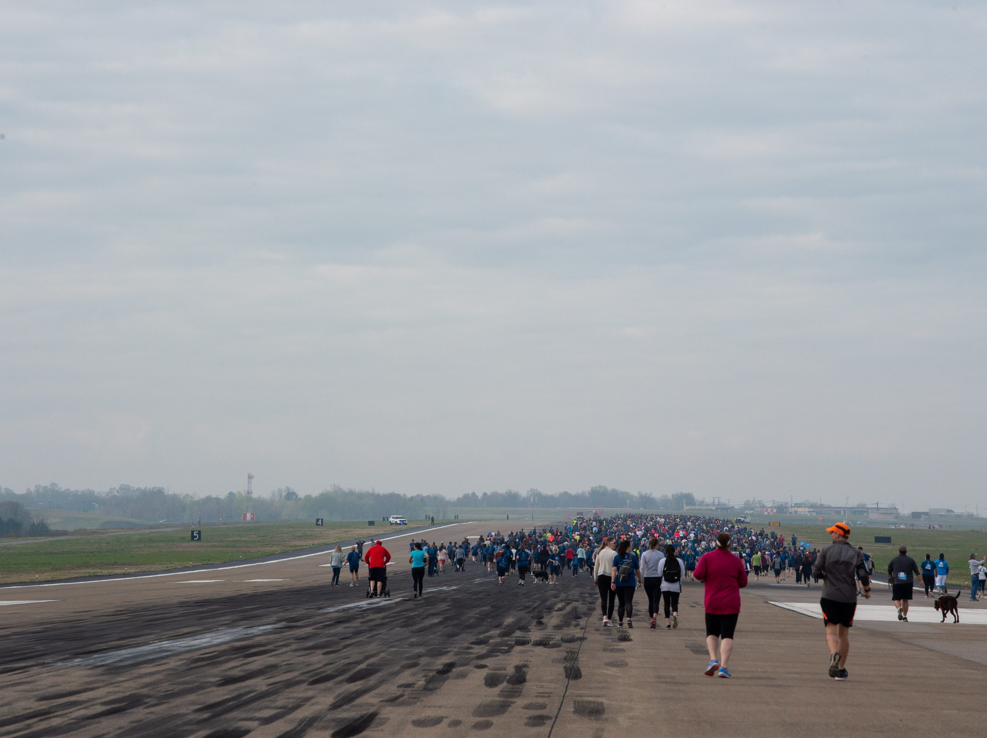 Participants begin the BNA 5K on the Runway at Nashville International Airport on Runway 2R/20L Saturday, April 6, 2019, in Nashville, Tenn.