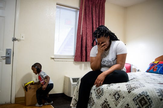 Domonique Union puts her head in her hand as her son Melvin Harrison Jr., 3, reaches for toys in their hotel room at InTown Suites Thursday, April 4, 2019, in Antioch, Tenn. Union served as an administrative specialist for the U.S. Marines and recently found herself homeless and seeking help from Operation Stand Down. She doesn't want her son to grow up without a home and is looking for employment and permanent housing for her family.