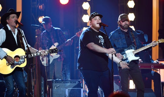 "Luke Combs joins Kix Brooks and Ronnie Dunn as they rehearse ""Brand New Man"" ahead of the 54th ACM Awards on April 5, 2019, in Las Vegas."