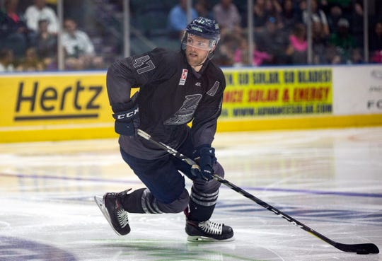 Florida Everblades defenseman Logan Roe moves the puck against Orlando on Friday. Florida opens the Kelly Cup Playoffs against Jacksonville on Thursday at Hertz Arena.
