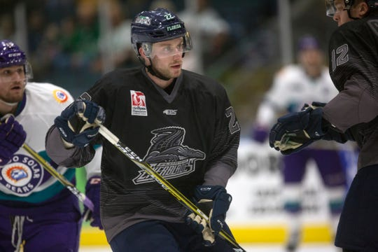 Florida Everblades' Sam Warning keeps his eyes on the puck during their game against Orlando on Friday. Florida opens the Kelly Cup Playoffs against Jacksonville on Thursday at Hertz Arena.