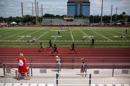 Athletes race at the Collier County Athletic Conference track and field meet at Naples High School on Saturday.