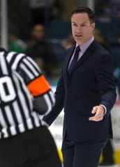 Florida Everblades head coach Brad Ralph speaks to the referee late in the regular season against Orlando.