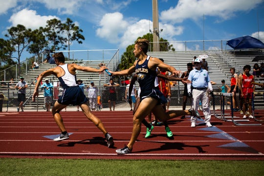 Athletes participate in a relay at the Collier County Athletic Conference track and field meet at Naples High School on Saturday.