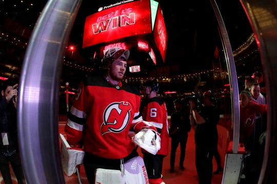 New Jersey Devils goaltender MacKenzie Blackwood (29) leaves the ice after an NHL hockey game against the New York Rangers, Monday, April 1, 2019, in Newark, N.J. The Devils won 4-2.