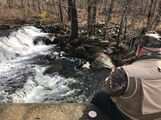 Ken O'Leary fishes on opening day near the falls of the Hibernia Fire Department station.