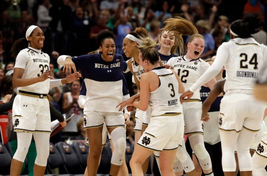 The Notre Dame team celebrate at the end of the second half of a women's Final Four NCAA college basketball semifinal tournament game against Connecticut, Friday, April 5, 2019, in Tampa, Fla.
