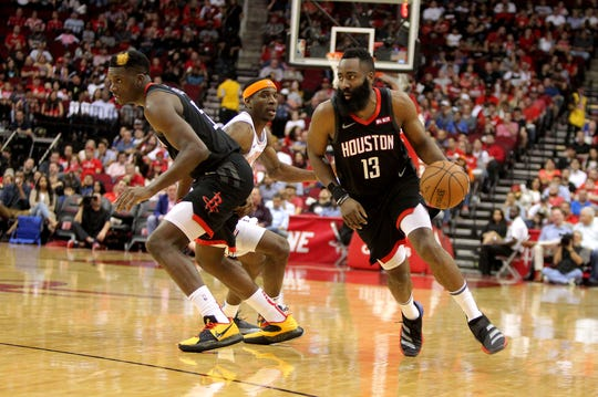 Apr 5, 2019; Houston, TX, USA; Houston Rockets guard James Harden (13) handles the ball against the New York Knicks during the second quarter at Toyota Center.