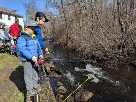 Jack and Christian Oakes fishing for trout on opening day.