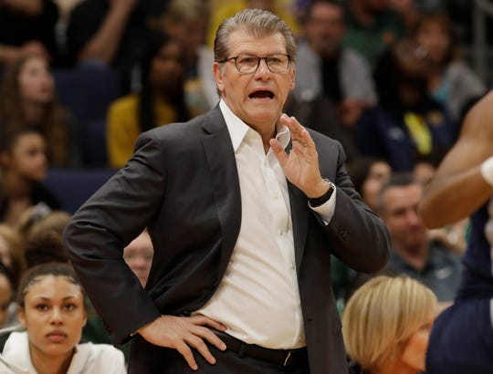 Connecticut head coach Geno Auriemma gestures to his team during the first half of a women's Final Four NCAA college basketball semifinal tournament game against Notre Dame, Friday, April 5, 2019, in Tampa, Fla.