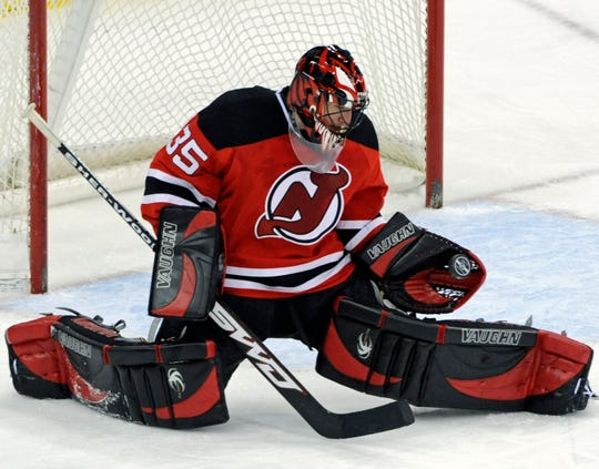 New Jersey Devils goaltender Scott Clemmensen gloves the puck during the third period of an NHL hockey game against the Boston Bruins Friday, Feb. 13, 2009 in Newark, N.J. The Devils beat the Bruins 1-0.