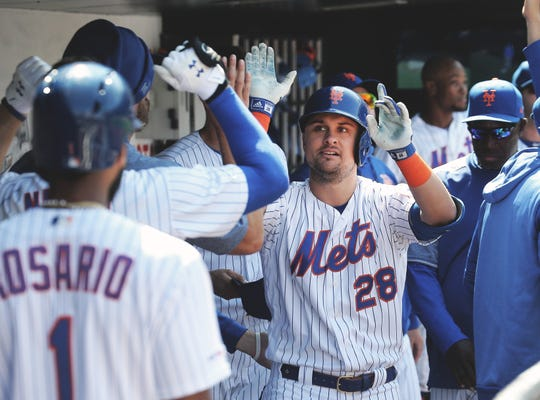 Apr 6, 2019; New York City, NY, USA; New York Mets third baseman J.D. Davis (28) is congratulated after hitting a solo home run against the Washington Nationals during the fourth inning at Citi Field.