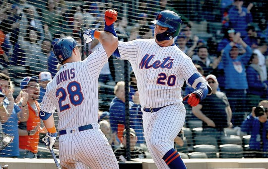 Apr 6, 2019; New York City, NY, USA; New York Mets first baseman Pete Alonso (20) is congratulated by third baseman J.D. Davis (28) after hitting a solo home run against the Washington Nationals during the eighth inning at Citi Field.