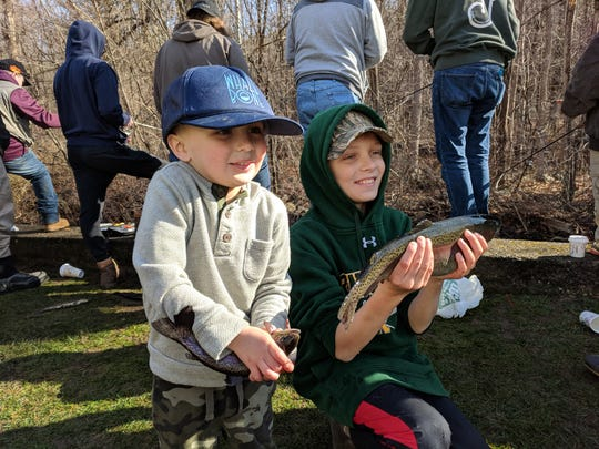 Lucas and Chase Bloete show off their catches on New Jersey's opening day of the trout season.