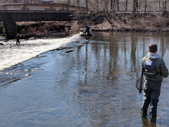 Anglers on opening day in the Rockaway River off Jackson Avenue.