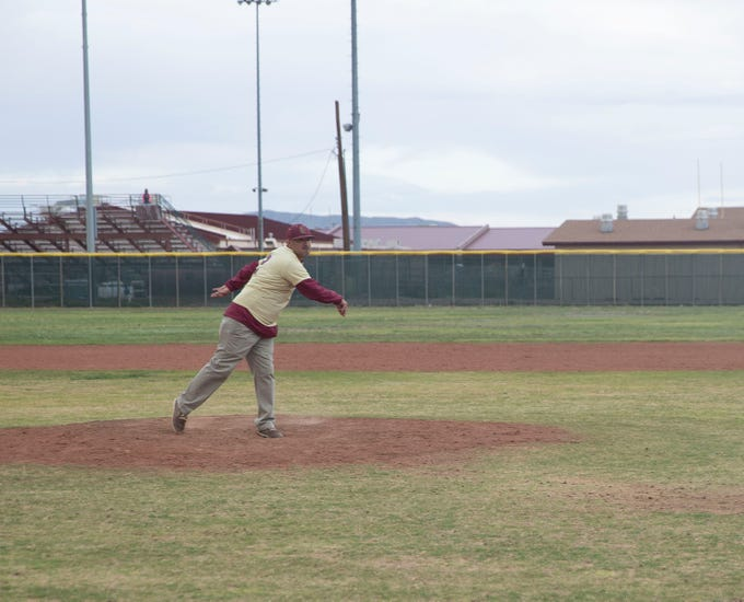 Beto Romero Sr. throws the first pitch at a baseball game at Gadsden High School in Anthony, New Mexico Friday April 5, to honor his son who was killed in a hit-and-run accident earlier this week.