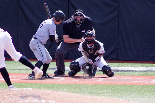 New Mexico State catcher Jason Bush makes stop during Saturday's game against Grand Canyon at Presley Askew Field.