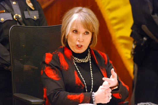 New Mexico Gov. Michelle Lujan Grisham describes her decision to veto 28 bills out of hundreds approved by the Legislature this year in Santa Fe, N.M., Friday, April 5, 2019. The governor has endorsed sweeping public education reforms and pay increases for public school teachers and state employees. Also Friday, the governor appointed a new leadership team for State Police in the wake of a scandal over charges of discrimination, retaliation and lewd behavior against a police chief under the previous administration.