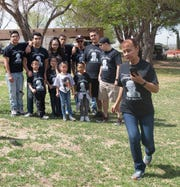 Irene Bustamante gathers with her family Saturday, April 6, 2019, at Young Park, for the Crime Victims' Expo and Walk. Bustamante's grandson, Johnny Ramirez, was killed Sept. 22, 2016.