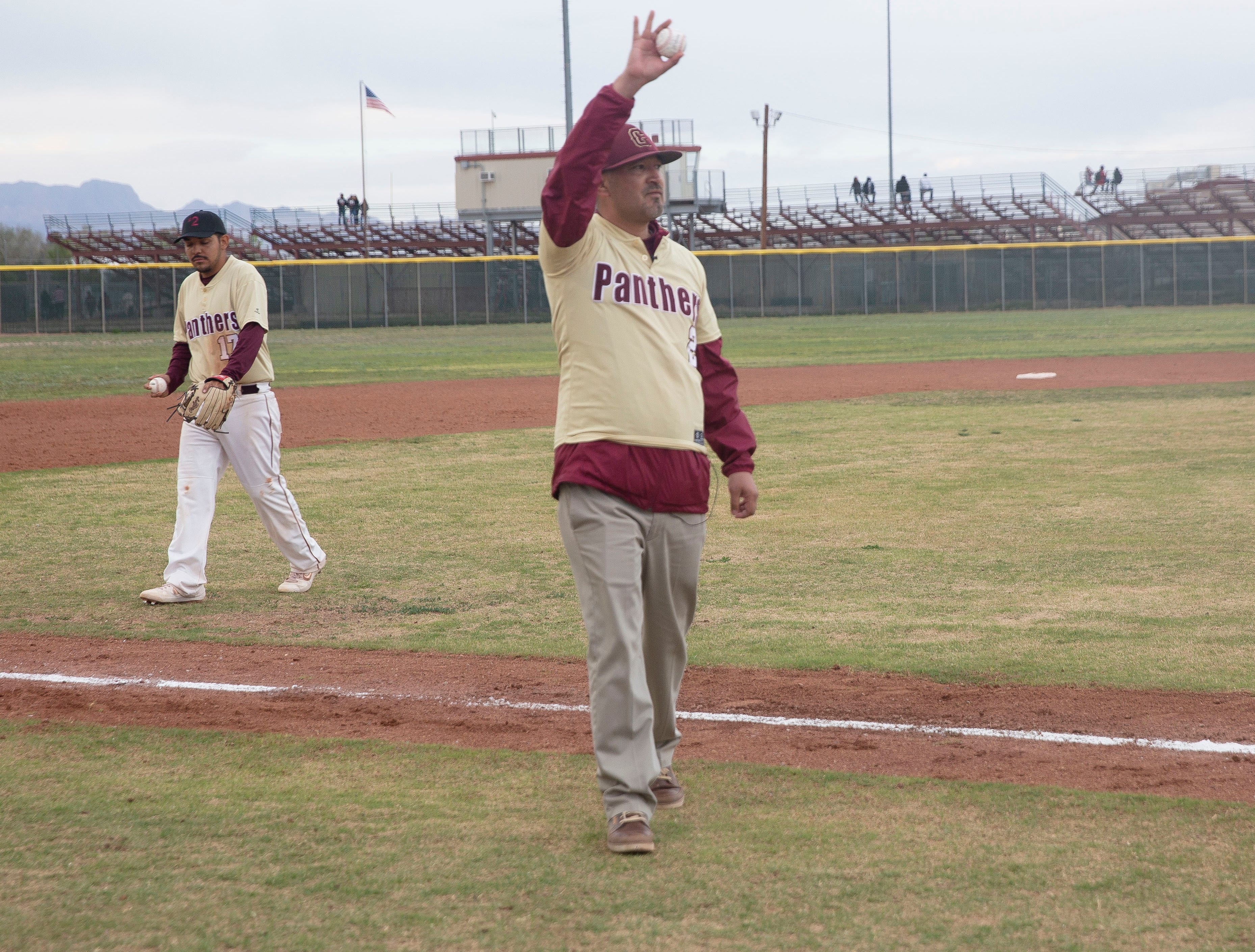 Beto Romero Sr. throws the first pitch at a baseball game at Gadsden High School in Anthony, New Mexico Friday April 5, to honor his son,, Beto Romero Jr., who was killed in a hit-and-run accident earlier this week.
