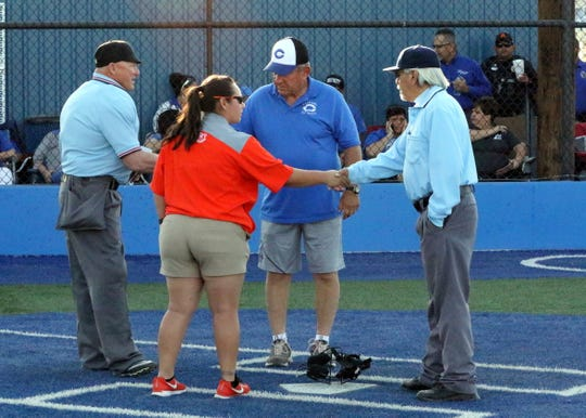 Artesia's Sandra Pulido, left, and Carlsbad's John Tiggert, right, shake the hands of the umpires before the April 5 softball game. Though the Eddy County War is a passionate rivalry, no fans were removed from the game and no fights took place. On Wednesday in Denver, a large group of parents got into a fight over a seven-year old little league baseball call.