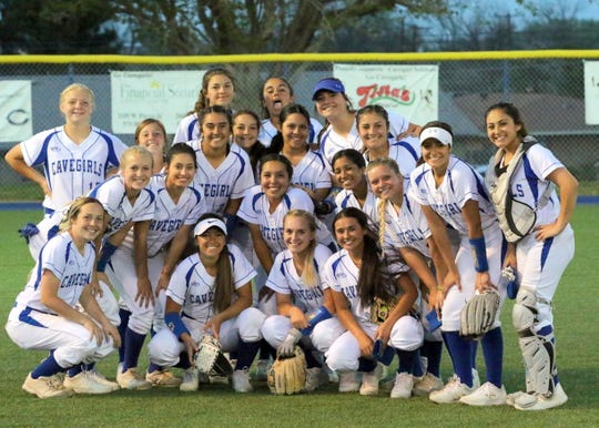 The Cavegirls take an impromptu team photo after beating Artesia 5-1 on Friday.