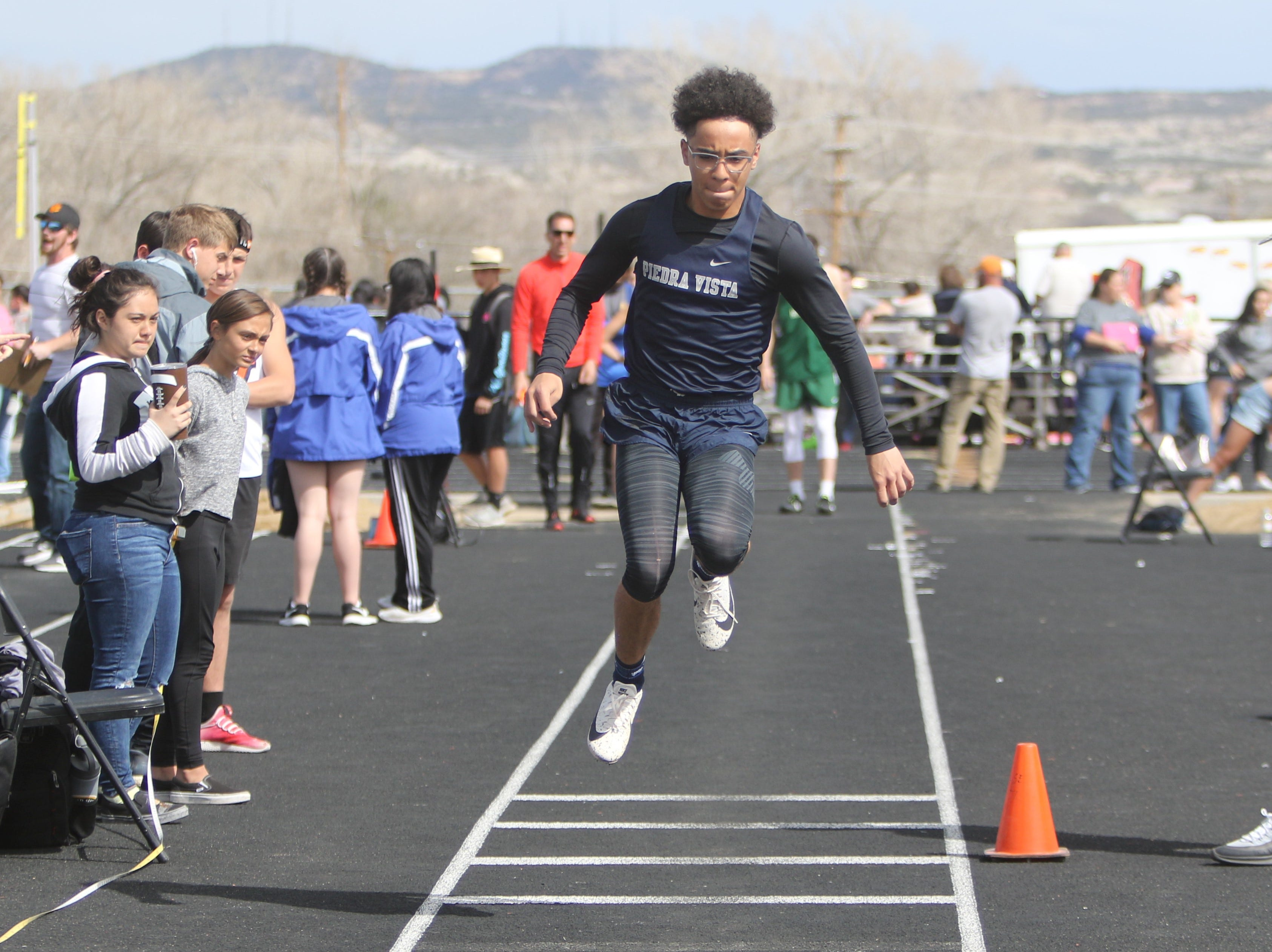 Piedra Vista's Connor King takes his first leap in the boys triple jump during Friday's Top Gun Invitational at Aztec.