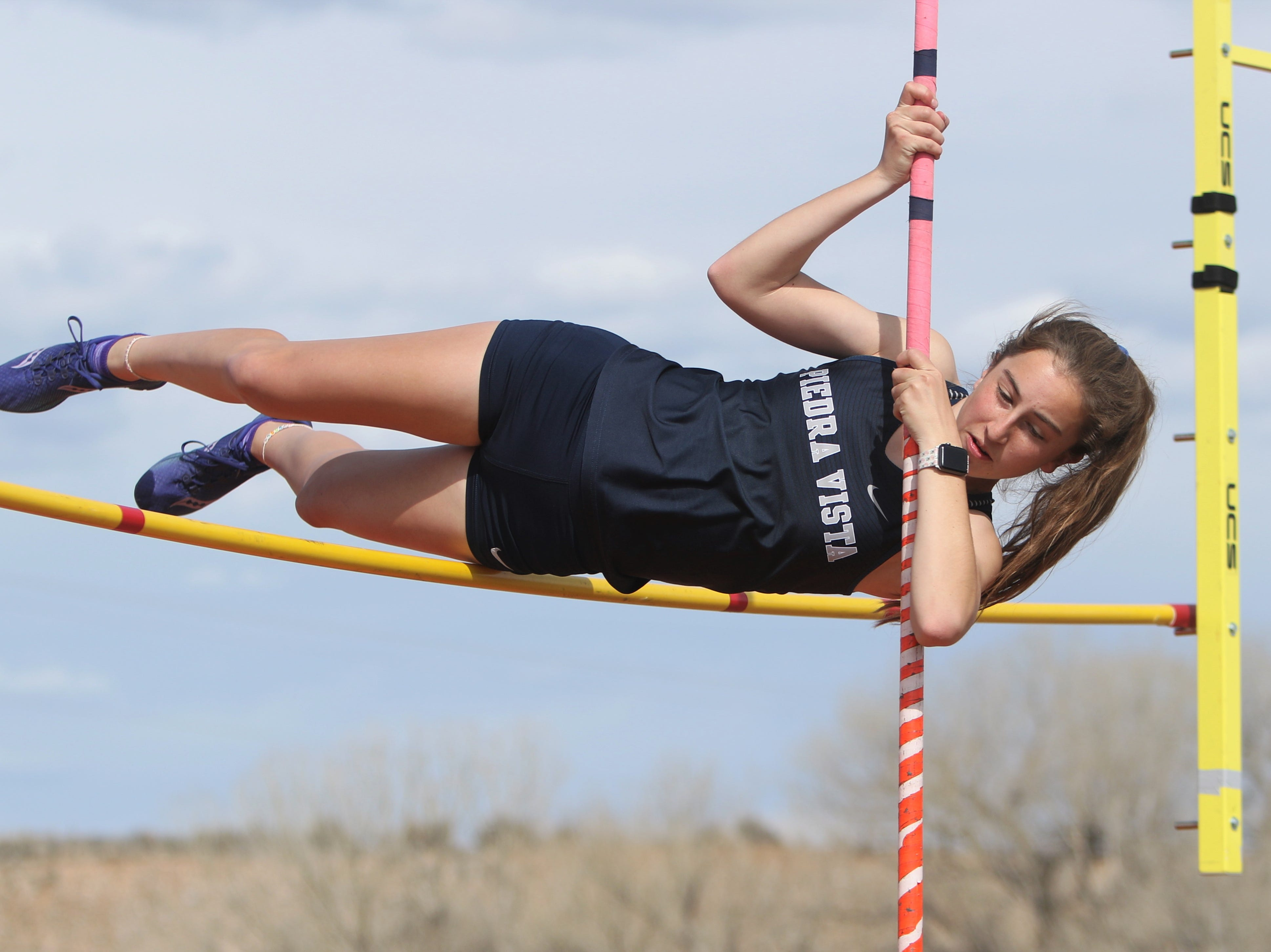 Piedra Vista's Jenna Basham clips the bar on way back down in the girls pole vault during Friday's Top Gun Invitational at Aztec.