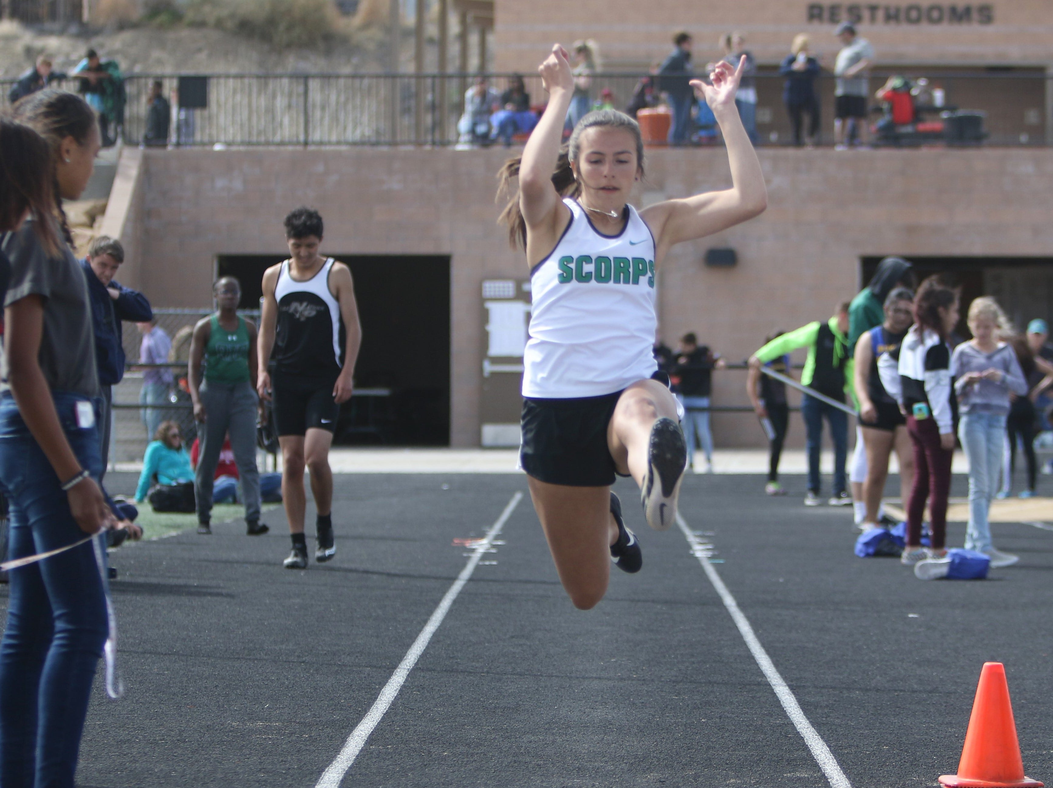 Farmington's Aubrey Jaeger catapults herself into the dirt in the girls long jump during Friday's Top Gun Invitational at Aztec.