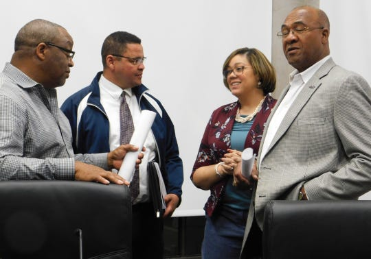 St. Landry Parish Council members Jerry Red,Jr., Dexter Brown and Jimmie Edwards speak with council clerk Sherell Jordan after a meeting last week.
