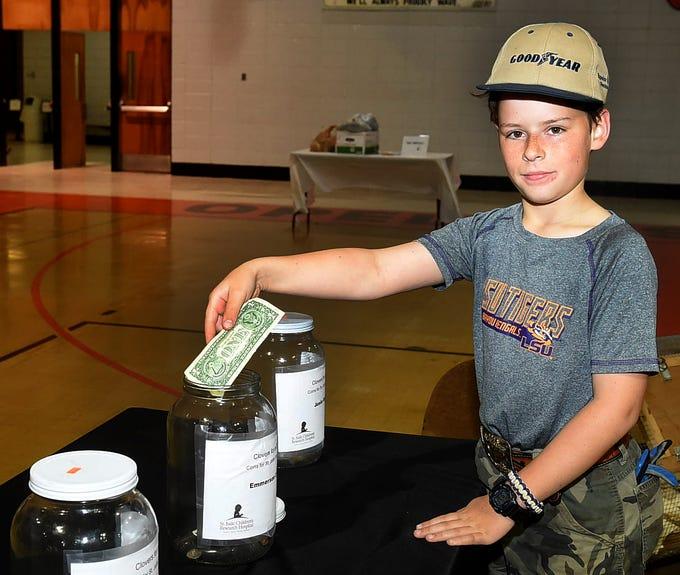 Eli Lyons donating to the St. Jude Foundation at Saturday's St. Landry Parish 4-H Achievement Day.
