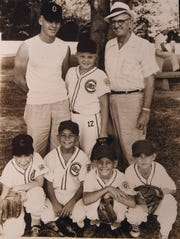 Jay Cormier (standing, center) is a 9-year-old in this picture during his Little League career in Opelousas.  Cormier's coach at the time, George Daigle, is on the right. A young John Bradley stands to the left of Cormier. In front kneeling are Cormier's teammates, Bobby Ardoin, Chip McCardell, John Daigle and Ronnie Carrier.