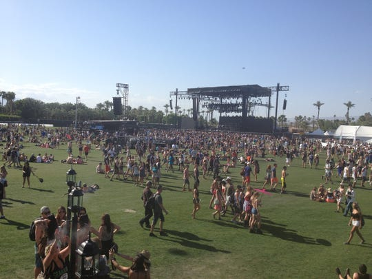 In this 2013 file photo, more than 80,000 people crowded into Indio, Calif., for the first weekend of the Coachella Valley Music and Arts Festival. The Desert Sun snapped images from the crowd -- including people wandering the grounds and the view from the top of the ferris wheel -- on April 12, 2013.