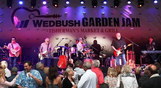 The Los  Angeles band, Los Lobos, performs Friday for dancers at the Wedbush Garden Jam at the Indian Wells Tennis Garden.